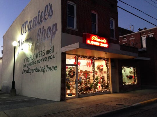 The warm glow of Christmas decorations shine at night falls at O'Daniel's Flower Shop at 127 N. Elm St., before the store was closed this month.