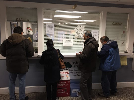 Parsippany residents line up to prepay their 2018 property taxes Wednesday.