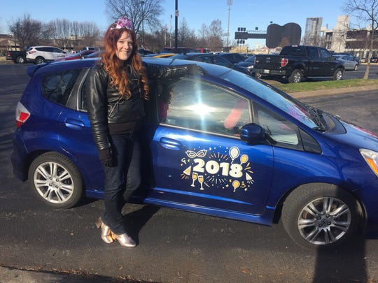 Lyft driver Rachel Pearl is ready for New Year's Eve with her car decorated.