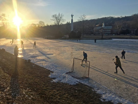Skaters playing hockey at Edgemont Park, Montclair after school on Tuesday.