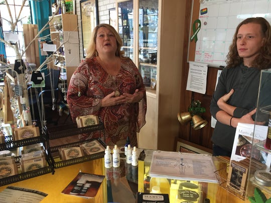 Kim Loeffler and her son, Jordan, sell CBD products at their Cedar Rapids shop, the Corner Store Apothecary.