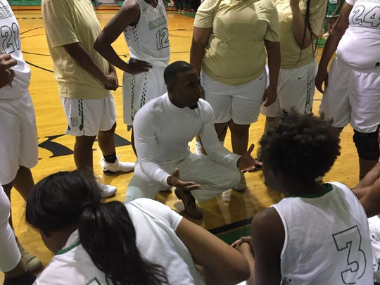 Bossier coach DeShawn Williams pleads his case during a timeout in Tuesday's game with Minden.