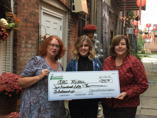 Founding board members of Grassroot Arts Initiative Barbara Smith (left) and President Mary Rettenmaier presented Howell High School student Alli Mitter with the new nonprofit's first arts education scholarship in October.