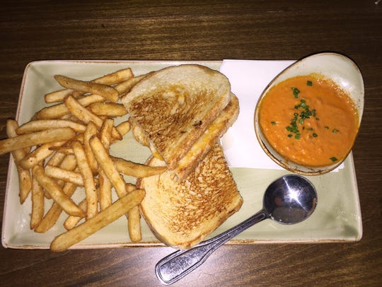 The grilled cheese sandwich with fries and tomato soup