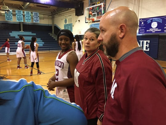 Minden coach Jacob Brown (right) talks with his team