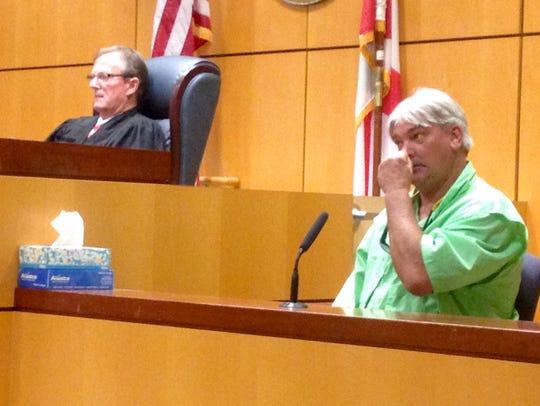 """Bruce """"Tim"""" Blake testifies during William Woodward's"""
