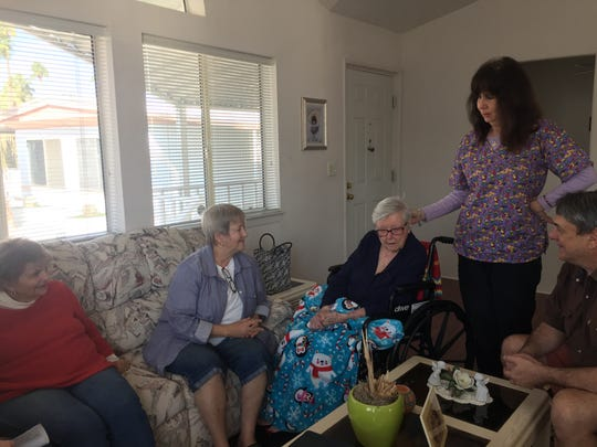 Jewel Marx, center, talks with friends at her home