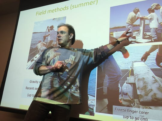 Andrea Lini, a University of Vermont geology professor, discusses methods of sampling soil beneath St. Albans Bay during a conference Monday at UVM's Davis Center. Photographed Jan. 8, 2017.