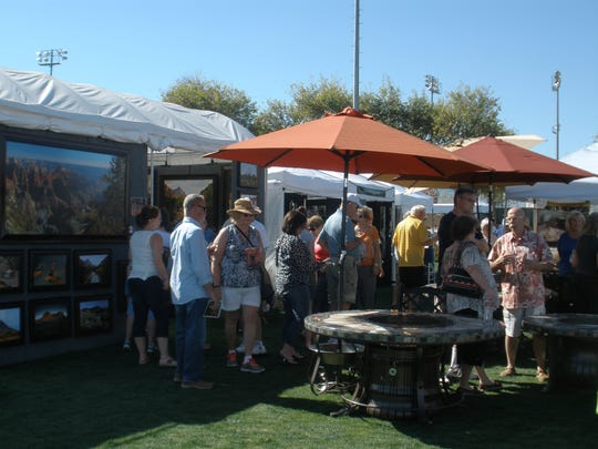 During the Surprise Fine Art and Wine Festival, patrons can browse fine art from artists from different parts of the country. 