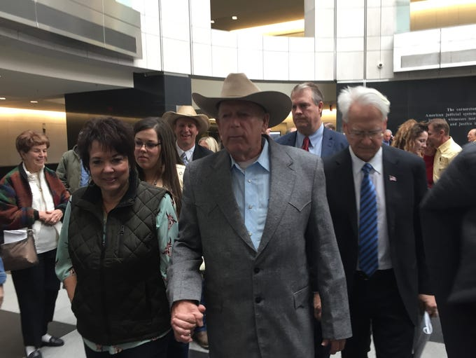Cliven Bundy, his wife, Carol Bundy, and his lawyer
