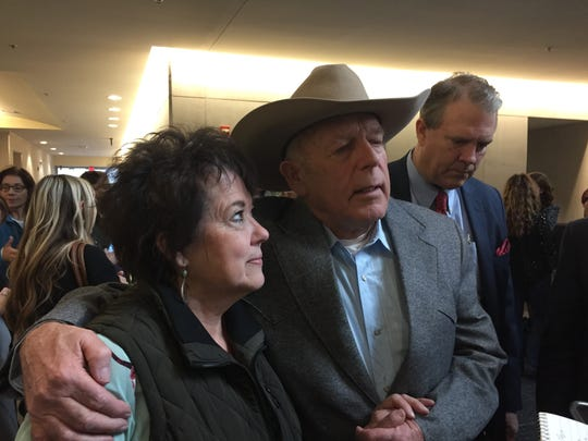 Cliven Bundy and his wife, Carol Bundy walk through the lobby of a Las Vegas federal courthouse on Jan. 8, 2018.