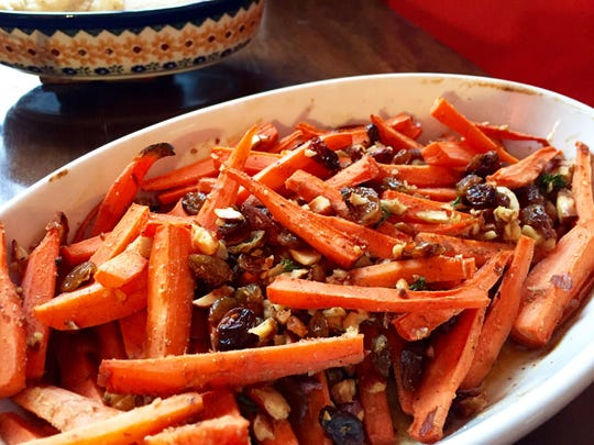 Roasted Spiced Carrots with Golden Raisins and Almonds are a nutritious winter side dish.