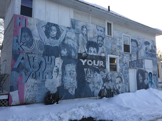 This mural at West Saginaw and Butler streets pays tribute to prominent black leaders ranging from sports to entertainment.