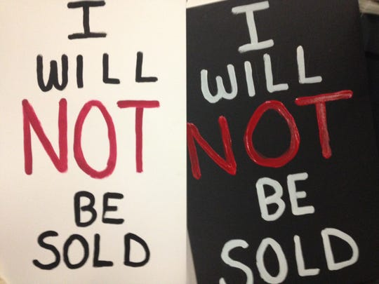 "High school students carried signs emblazoned with ""I will not be sold"" across the stage at the end of an anti-trafficking event presented Thursday by Soroptimist International of Simi Valley."
