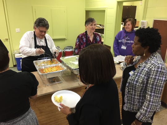 Members of Mosaic Palm Bay share a fellowship meal. The congregation heard a prayer for Martin Luther King Jr. and were invited to attend a Peace march on MLK DAY