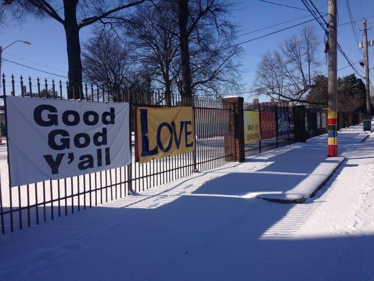 Snow coats the sidewalk on Alabama Avenue outside St.