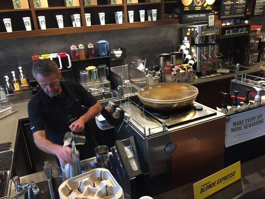 Craig Beaton prepares a mocha at the Hyatt Regency Starbucks in downtown Greenvlle during a snow storm Wednesday. He and his colleagues were at work as usual by 5:30 a.m.