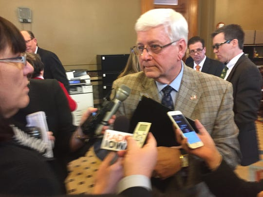 Department of Human Services Director Jerry Foxhoven talks to reporters at the Statehouse after testifying to the Senate Human Resources Committee.