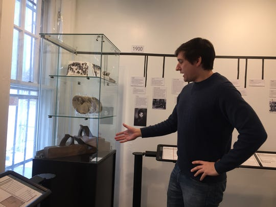 Josh Lisowski, collections director at the Camden County Historical Society, shows some of the Moore Family artifacts on display at Pomona Hall.