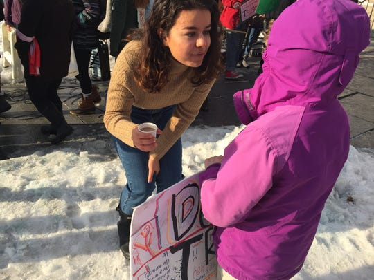 Hope Petraro, a Montpelier  High sophomore who organized and emceed a youth march on Jan 20, 2018, tells an excited 9 year-old how to get politically involved