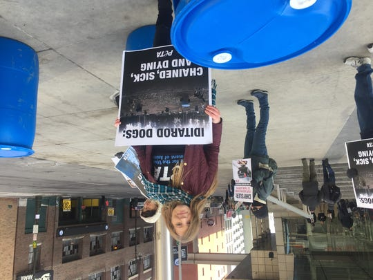 PETA campaigner Tricia Lebkuecher led a group of protesters outside Cobo Center in 2018.