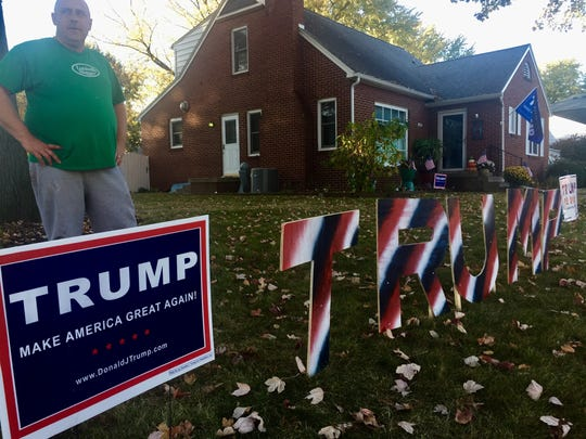 In this November 2016 photo, John Hamilton shows how he rebuilt  pieces of his Donald Trump yard signs after some were trampled or taken ahead of Election Day.