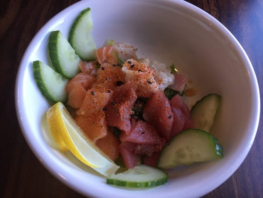 The rainbow poke salad at Cove Sushi features fresh,