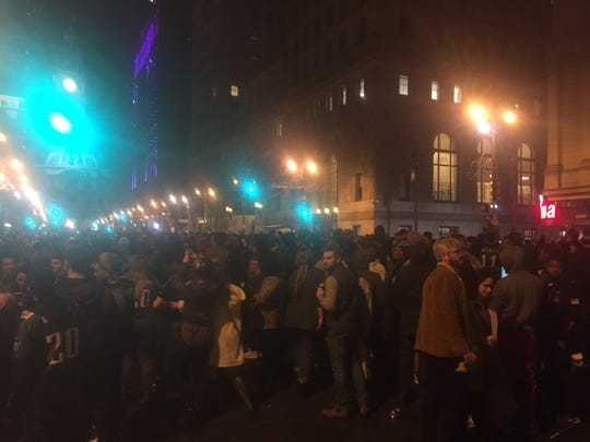 Eagles fans gather to celebrate around the corner of Broad and Walnut streets in Center City Philadelphia Sunday night.