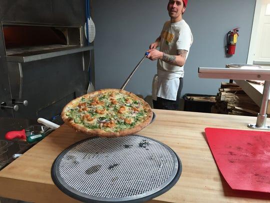 Folino's Pizza employee Bobby Seaman takes a Fire Kracker