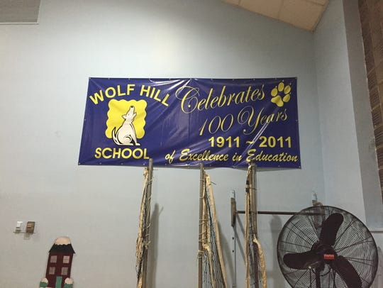 A banner in the Wold Hill Elementary School auditorium
