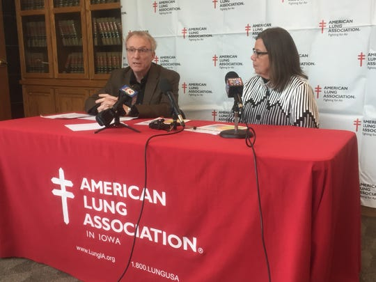 Dr. Mike Witte, a Des Moines pulmonologist, and American Lung Association administrator Pat McKone, speak at an anti-smoking press conference Friday in Urbandale.