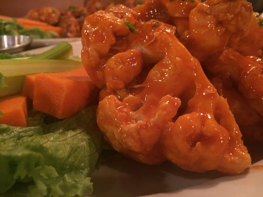 "Buffalo ""wings' made vegan using cauliflower and non-dairy ingredients were part of an inclusive menu at Shelburne Tap House on Jan. 16, 2018."