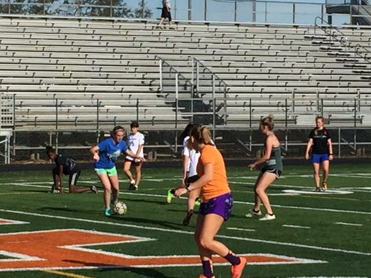 Lely sophomore Saoirse Bowe maneuvers with the ball during a practice drill Tuesday afternoon. Bowe is second on the Trojans with six goals and third with eight assists this season.