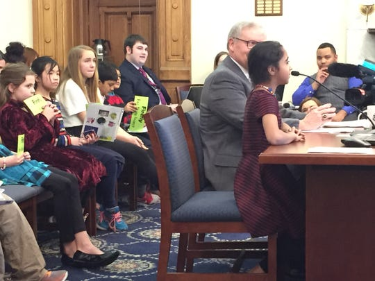 Yashi Varma, a third grader at Cumberland Elementary School, testifies asking state lawmakers to support naming the Say's Firefly as the state insect.