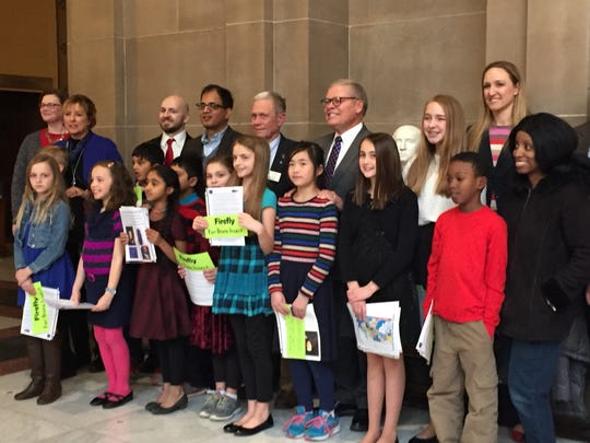 The students and their parents with Senator Ron Alting after the Senate's public policy committee voted to move the state insect bill out of committee Wednesday.