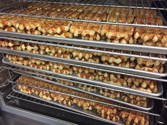Trays of Liège Belgian waffles cool at Waffle Envy's
