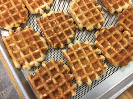 Liège Belgian waffles are hot off the iron at Waffle Envy in Reno. The two-man operation can produce roughly 300 waffles an hour.