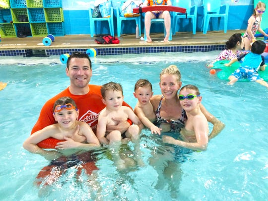 (l to r) The Goldfish Swim School owners Chris McCuiston and Jenny McCuiston with their 4 sons  Jack, Brody, Reid & Charlie in the pool at the Birmingham location during their 10-year anniversary party in 2016.