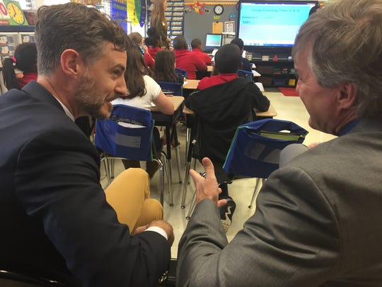 State Superintendent John White (left) and Monroe City Schools Superintendent Brent Vidrine talk Thursday while they observe a class at Sallie Humble Elementary.