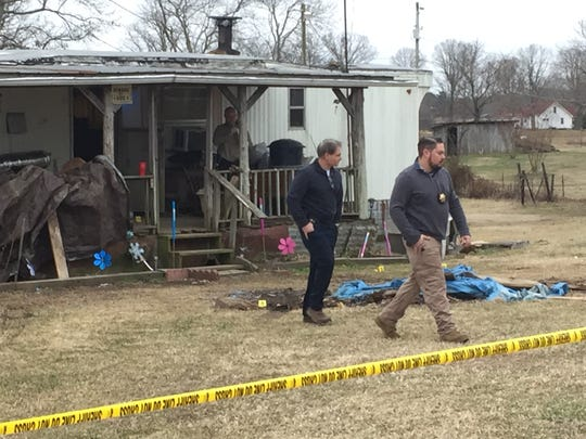 Montgomery County Sheriff's Office investigators at the scene of a home invasion shooting on Louise Road.