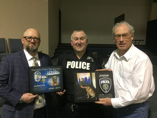 Randy Morton and his K-9 partner Junior were honored by Pataskala Police Chief Bruce Brooks and Mayor Mike Compton with special plaques on Feb. 1.