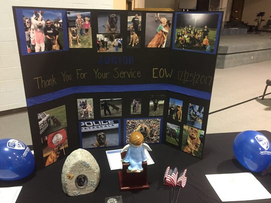 A display at the Feb. 1 tribute spotlighted many of K-9 Officer Junior's community interactions.