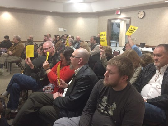 A group of Springfield residents holds signs in support