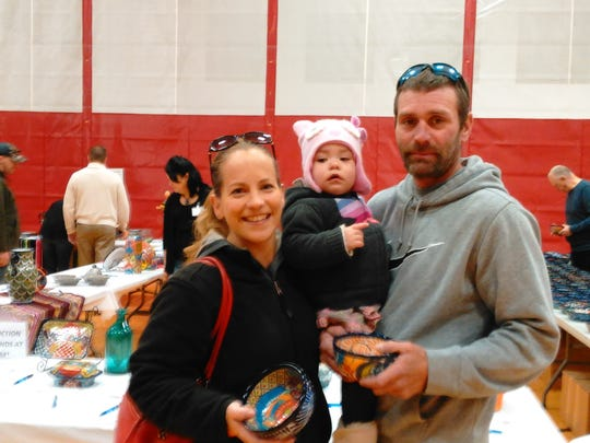 A family takes in the festivities of a past Love Bowls soup benefit event for Fresh Meals on Wheels of Sheboygan County,Inc.