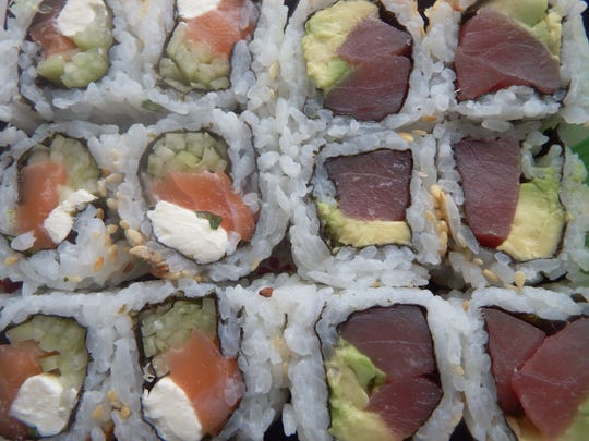 A Philadelphia roll,left, and a tuna, avocado roll,