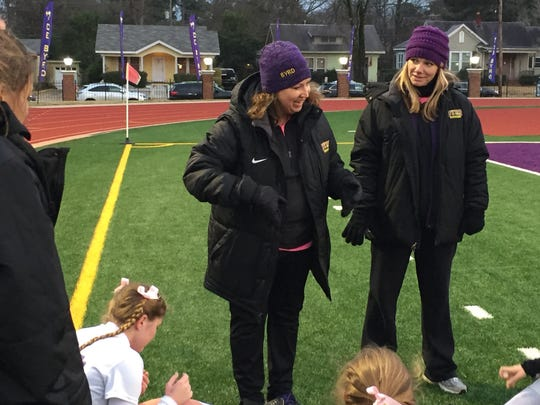 Byrd coach Lisa Levermann shares a laugh with her team