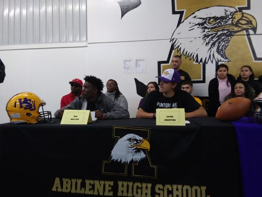 Abilene High receiver Raekwon Millsap, left, and punter Jacob Johnston wait to give their commitments to Hardin-Simmons during a National Signing Day ceremony Wednesday at Abilene High School.