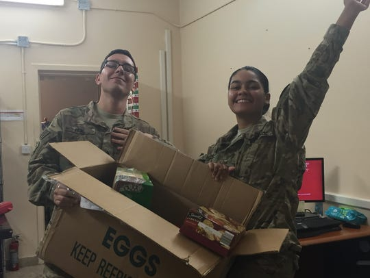 Appreciative soldiers abroad celebrate arrival of  their care box from Operation Yellow Ribbon of South Jersey