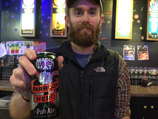 Jake Wirth, a bartender at the Magic Hat Artifactory store in South Burlington, holds a can of Barroom Hero.