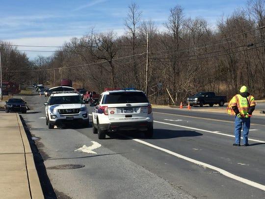 Police investigate the scene of a crash involving a
